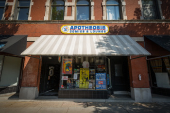 storefront with striped awning