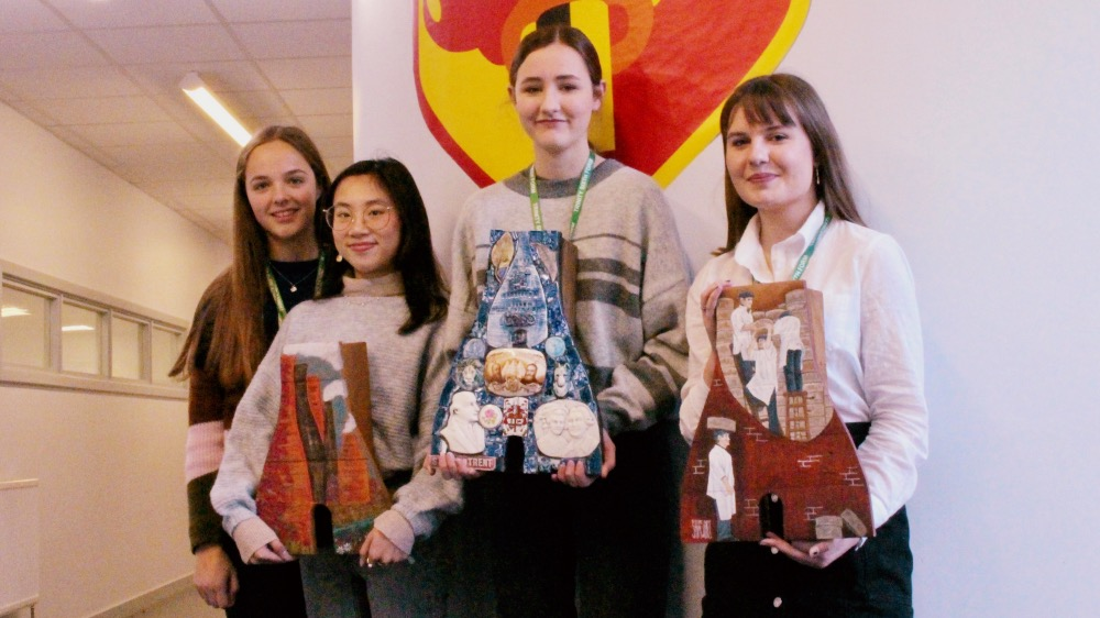 Students with Artisan Bottleoven Planters