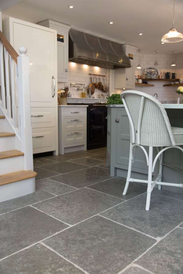 Denham Limestone Seasoned Finish in a walkthrough kitchen
