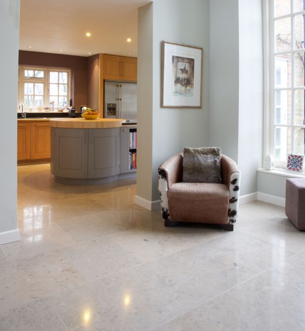 Firmdale Limestone Honed Finish in a through kitchen living room