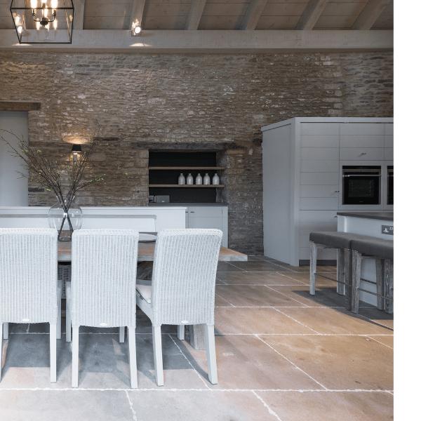 Neranjo Seasoned Limestone in an open plan dining area