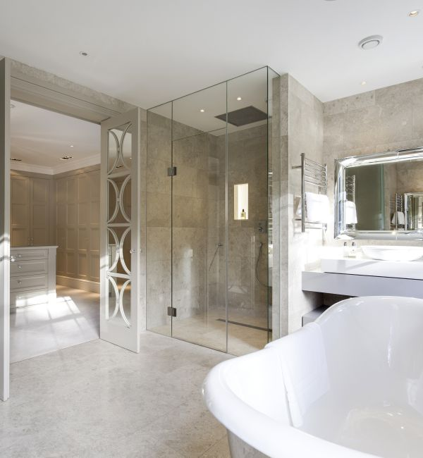 Piccadilly Honed Limestone within a shower room with a tiled shower enclosure