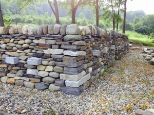 Master dry stone wall feature: right angle