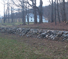 Old road side dry stone wall in need of repair