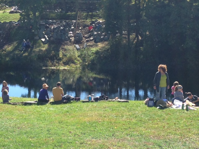 Lots of visitors to the farm looking across the pond at the Master Features Park