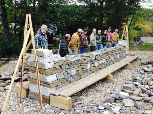 A level 2 dry stone walling workshop working on a High Wall Feature