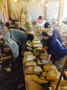 Dry stone wall workshop working on first Lift