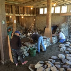 Women's dry stone walling workshop setting through stones on wall