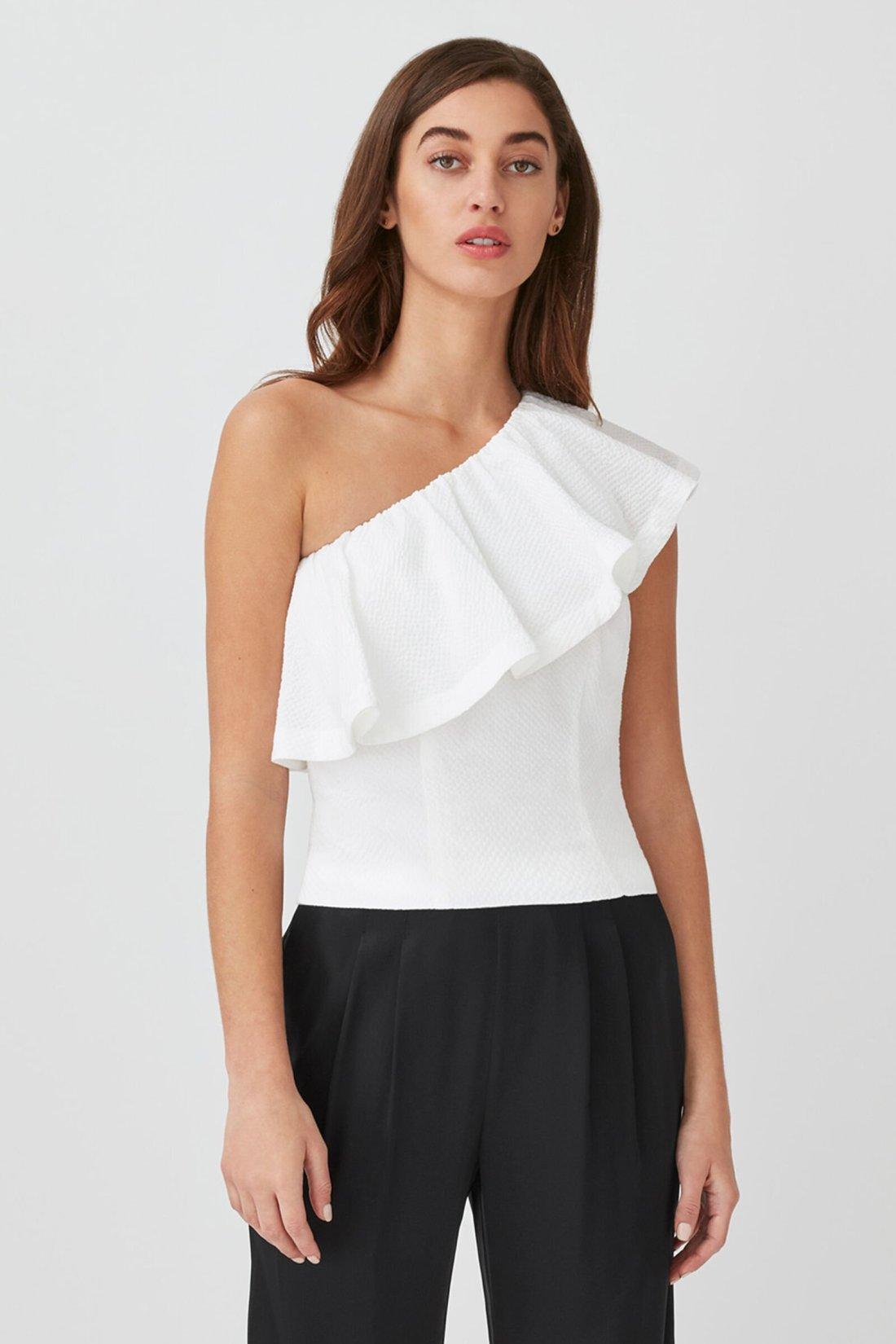 Female model wearing Cuyana Cropped Flounce Top in White