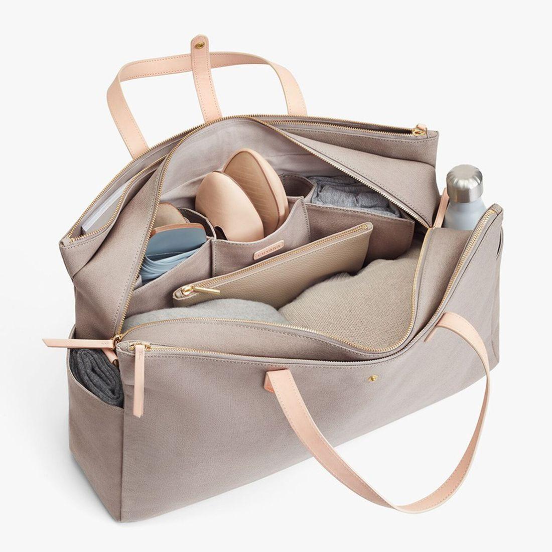 Product image of Cuyana Triple Zipper Weekender Bag in Soft Grey Detail
