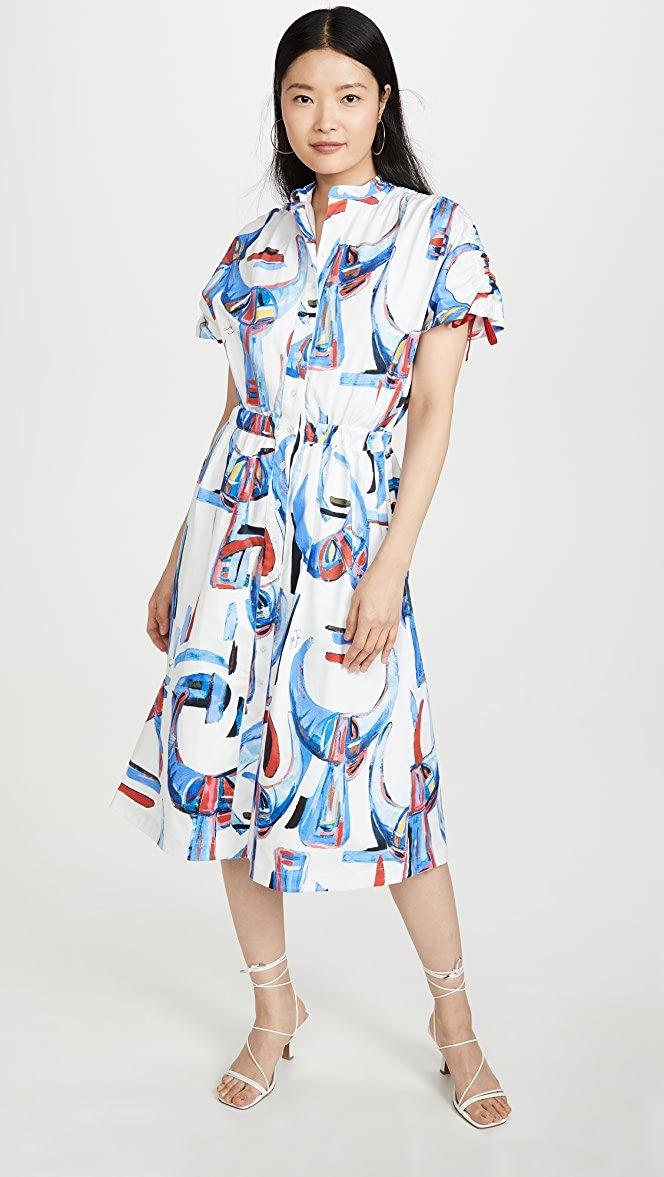 Asian female model wearing Rasatello Corna Dress by Stella Jean