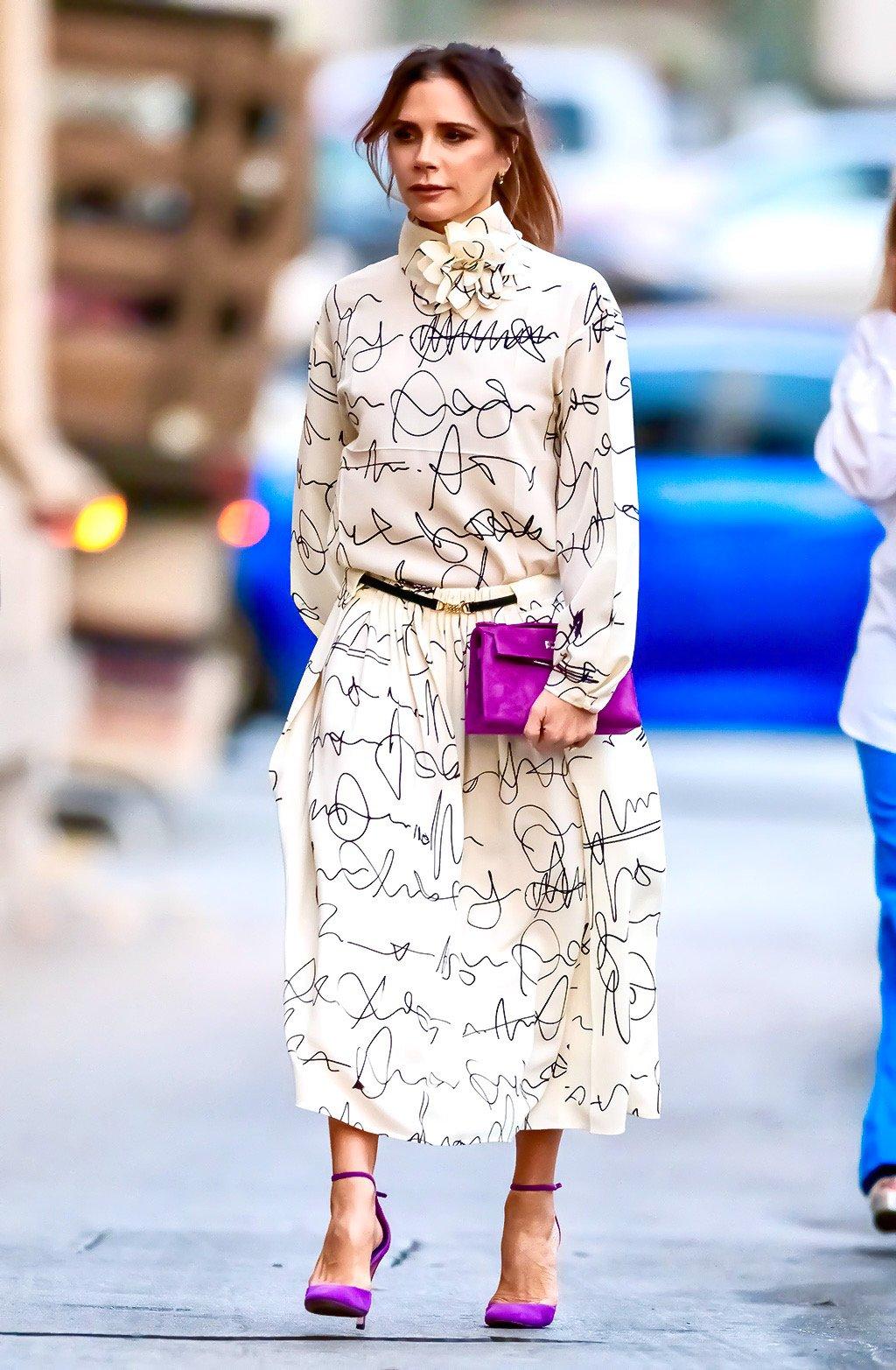 Victoria Beckham walking to Jimmy Kimmel Live! wearing her own Spring 2020 Victoria Beckham Long-sleeved Dolman Midi Dress in Scribble Print