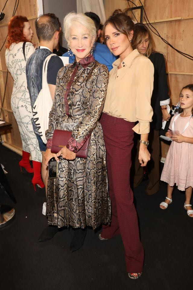 Actress Helen Mirren wearing Victoria Beckham snake skin shirt and skirt poses with designer Victoria Beckham at Victora Beckham Spring 2020 Fashion Show at London Fashion Week