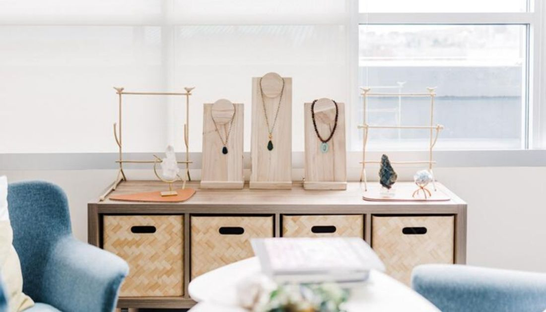 Three necklaces lay on jewelry display bust