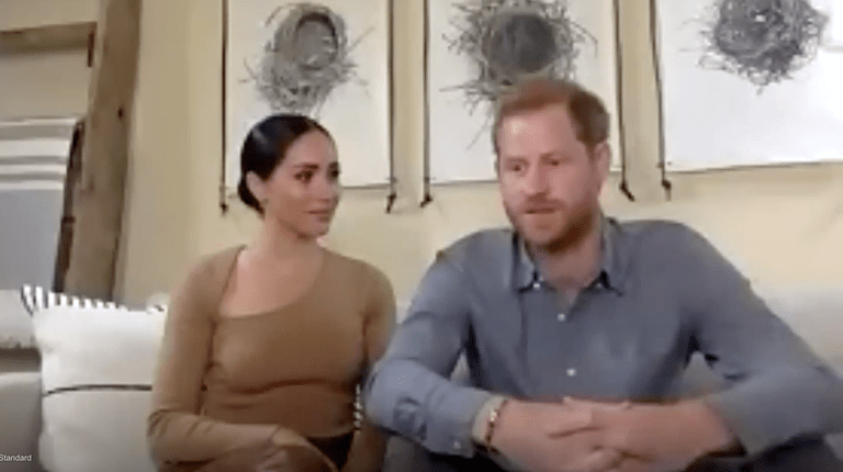 Meghan Markle sitting with husband Prince Harry in a Zoom interview with Evening Standard wearing Victor Glemaud Cut Shoulder Sweater