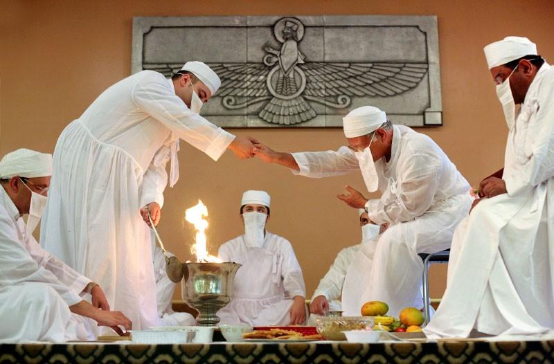 Zoroastrian priests worshipping Ahura Mazda