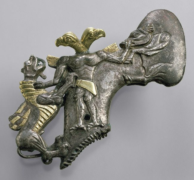 Gold and silver casting of a winger lion and eagle-headed man, found at Gonur