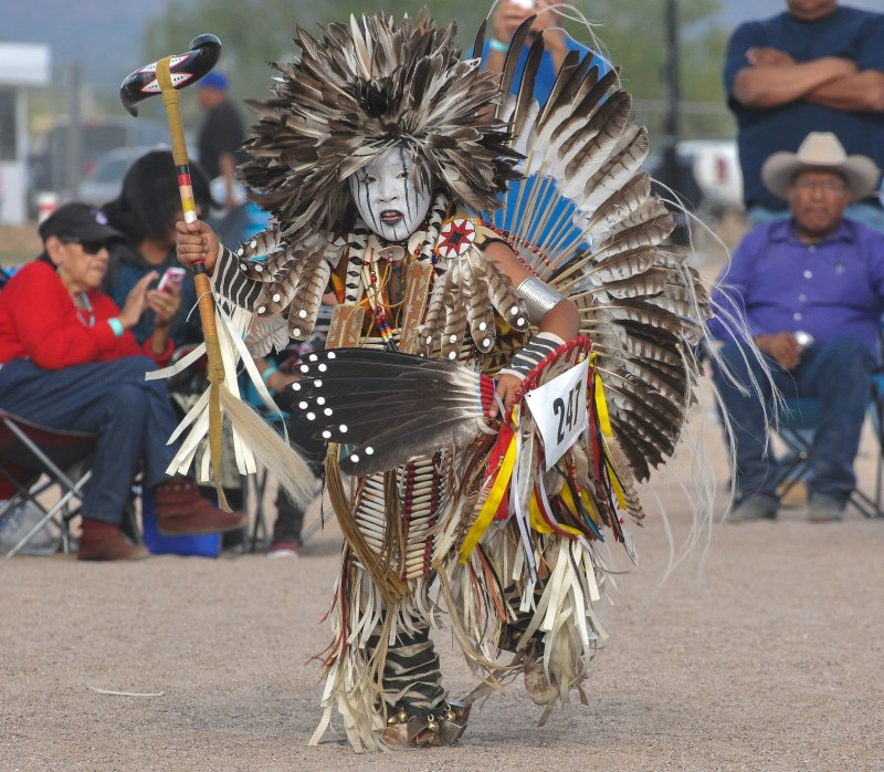 A child of the modern Totono O'odham performs in a traditional dance competition in Arizona