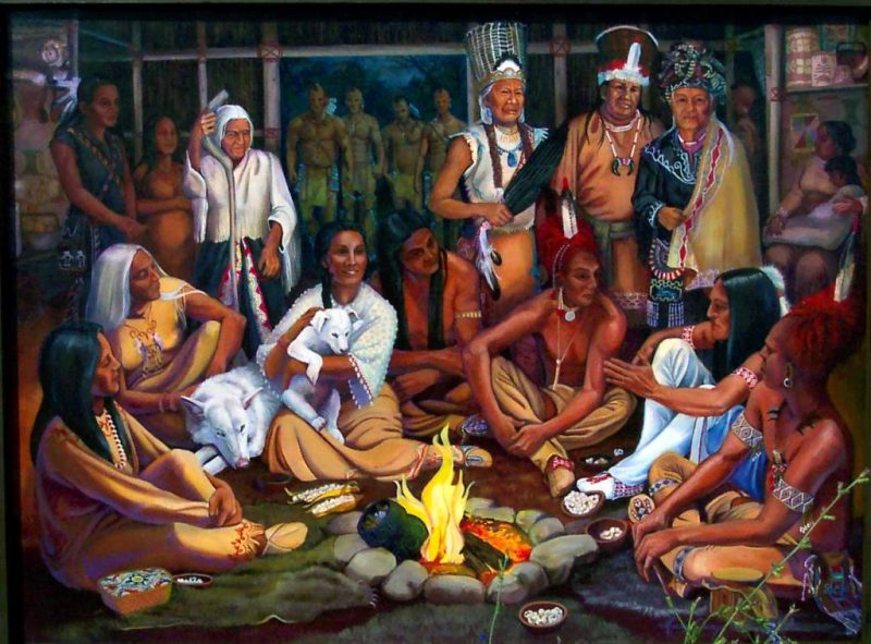 Iroquois men and women around the fire