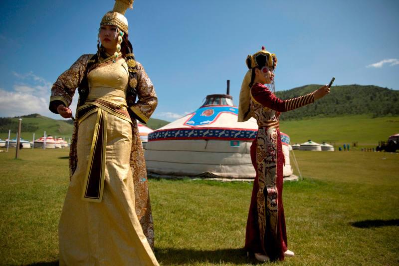 A woman snaps a selfie in modern Mongolia