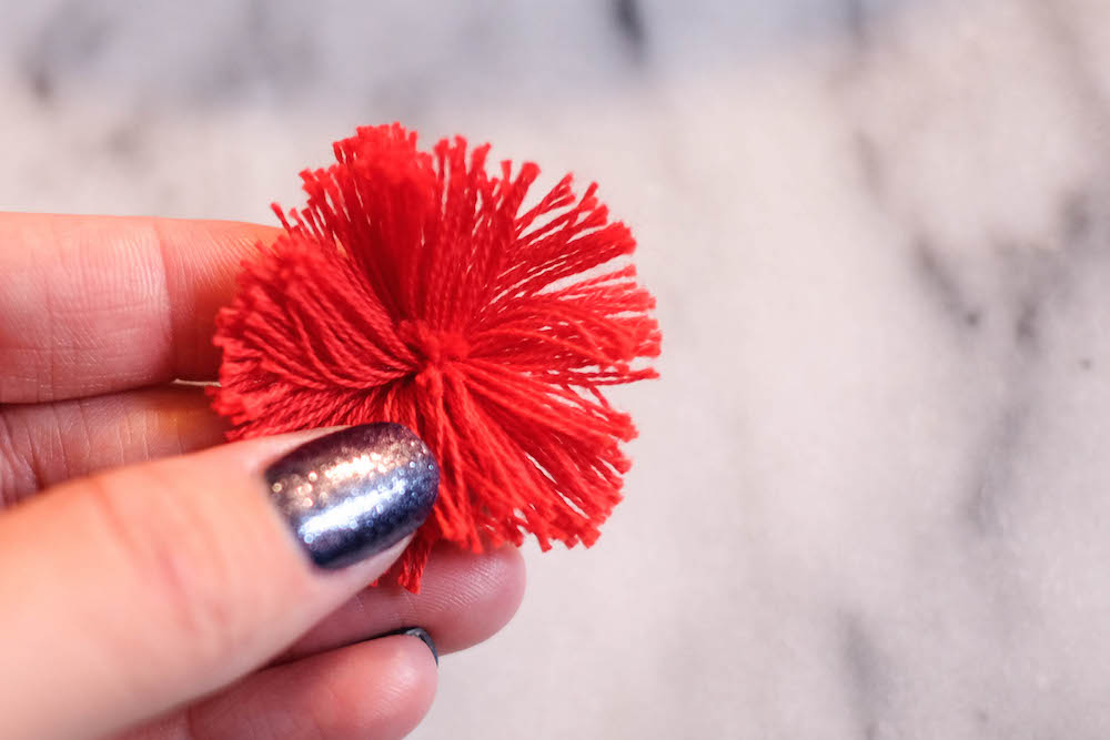 diy tassel earrings // the stripe blog: easy tutorial to create layered multicolor tassel earrings.