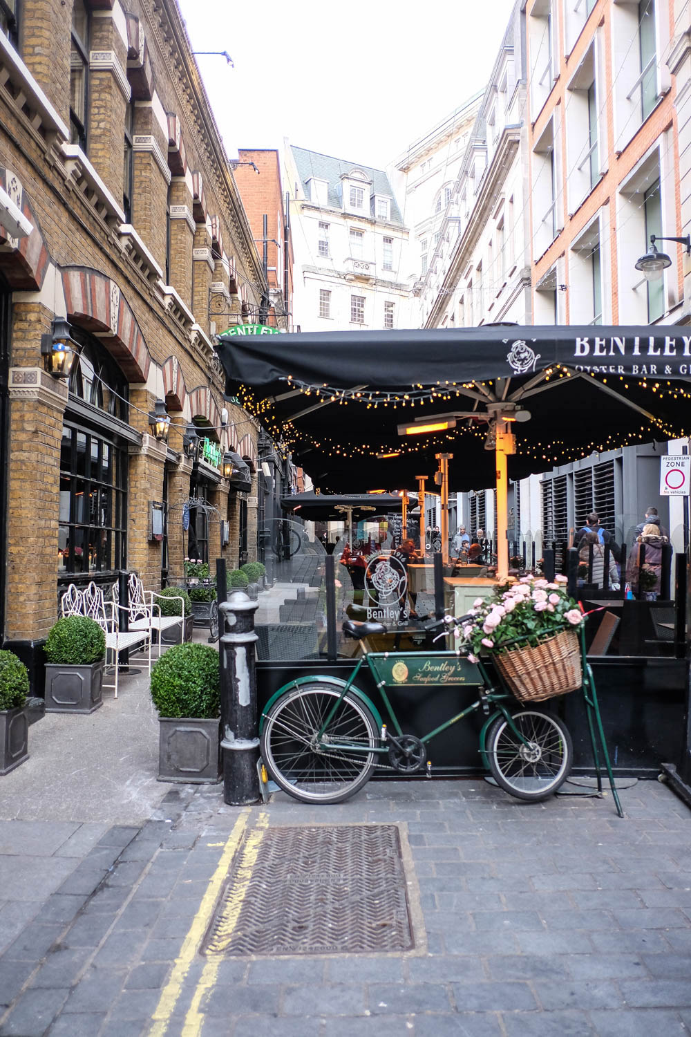 beautiful london, bicycle with flower basket - bentley's seafood grocers | 36 hours in london, the stripe