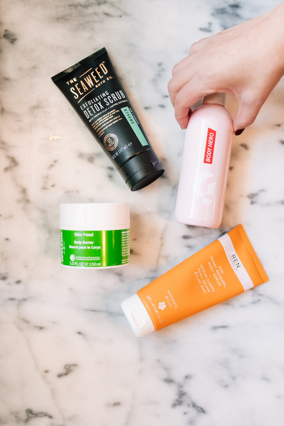 my favorite body products for dry skin   the best body wash, body scrub, body serum, and body butter! #beauty #skincare #beautyblogger #glossier   thestripe.com