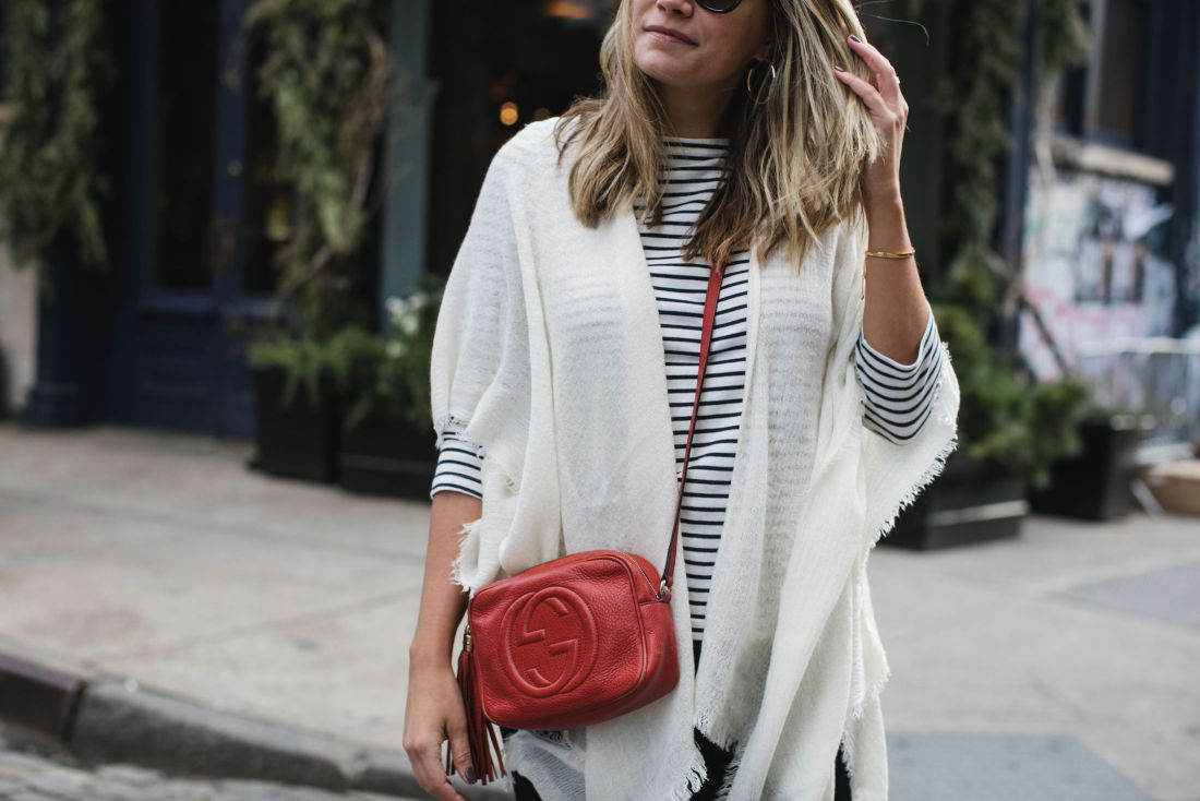 triped t-shirt (similar) // Echo Fringe Trim Cape (exact) // Paige Jeans // Gucci Soho Disco Bag  //