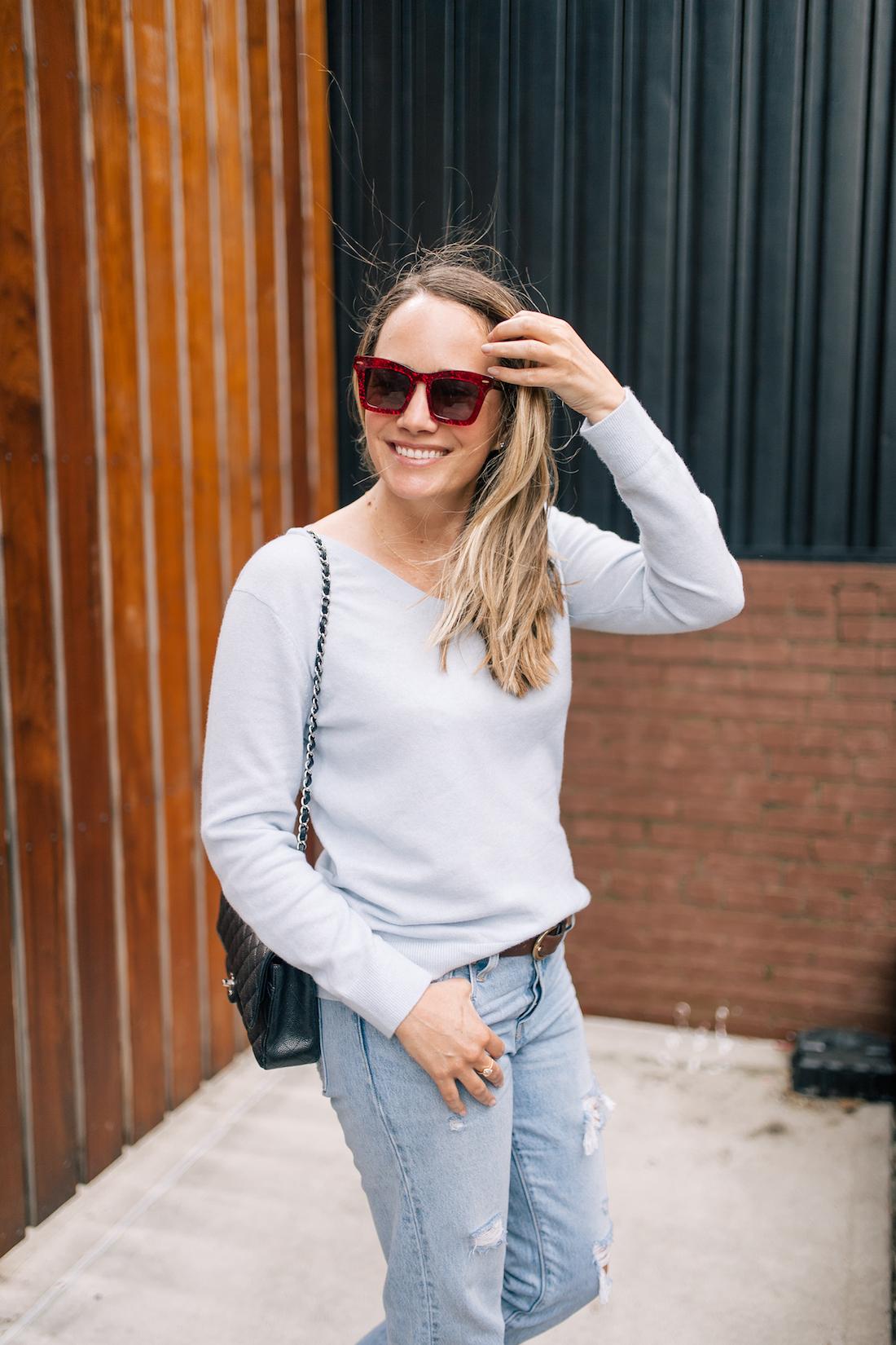 Grace Atwood's outfit details: Vince Cashmere Sweater // Levi's Jeans  // Sarah Flint Tortoise Slingbacks // Old J.Crew Belt // Chanel Purse // Karen Walker Sunglasses