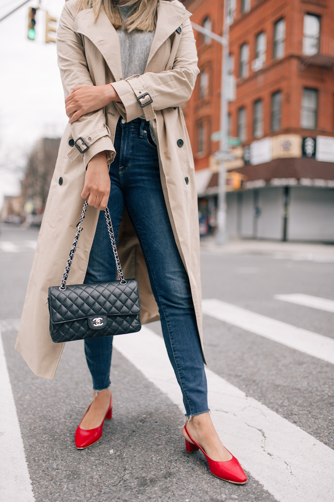 black chanel bag and red pumps