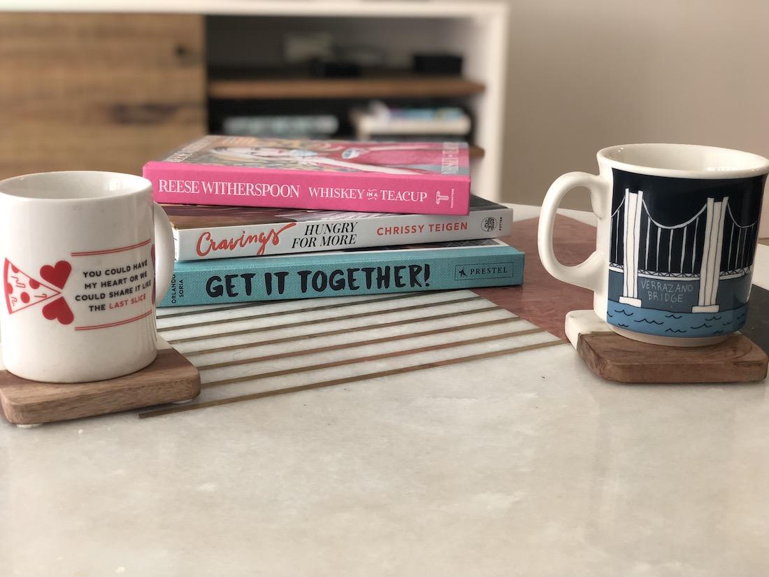Coffee mugs and books