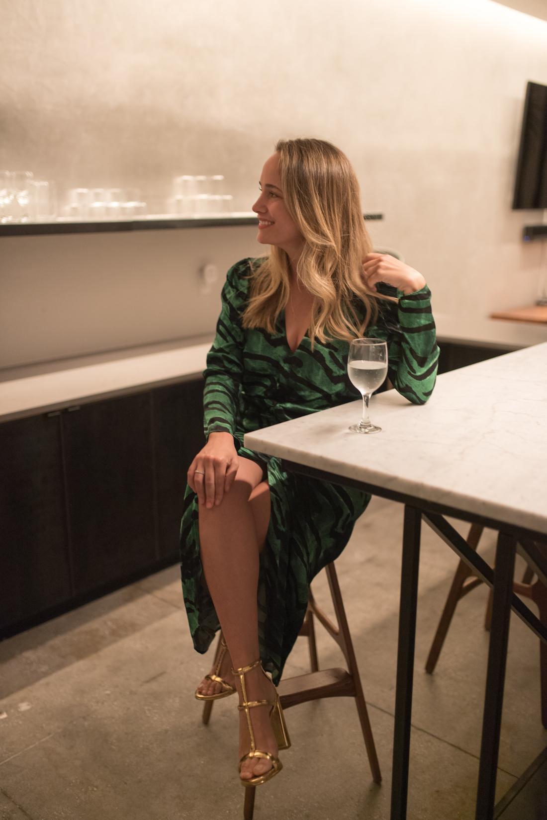 Grace is wearing a emerald green dress