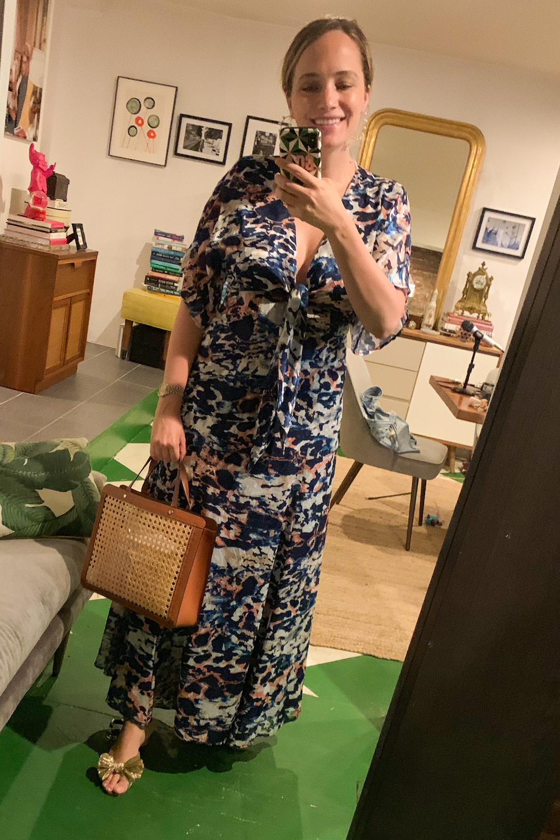 a floral dress and a structured bag
