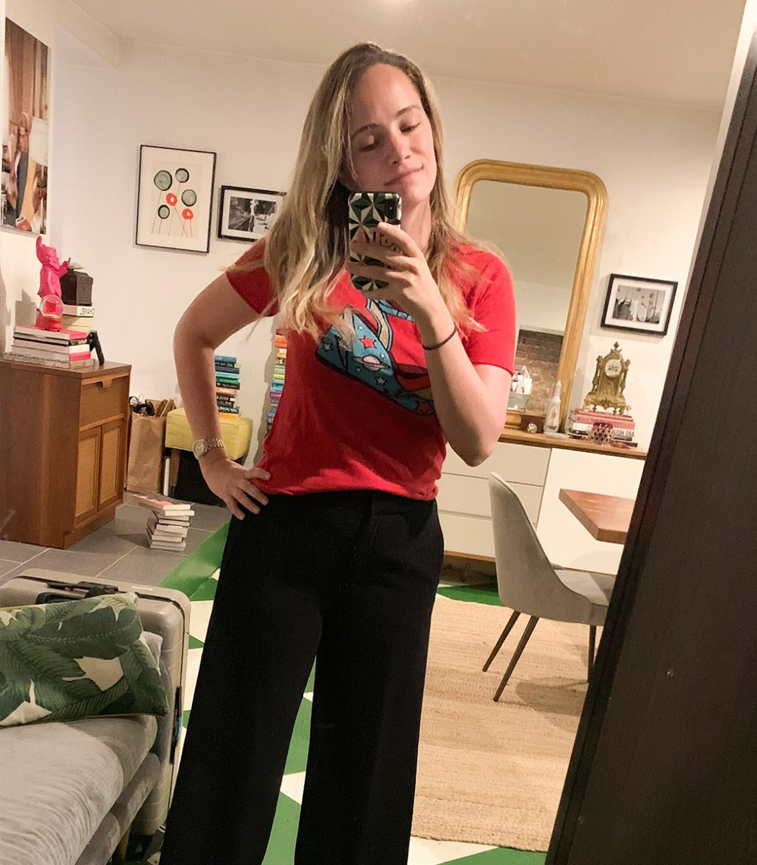a black pant and red shirt in What I Actually Wore