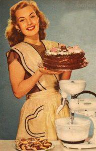 recipe exchange woman showing off cake