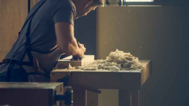 man person wooden table work