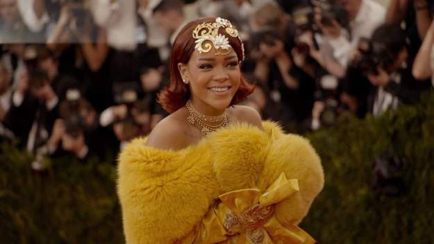 Rihanna Arriving at the Met Gala in a Wrap that Took Two Years to Create (She was also the Evening's Performer)