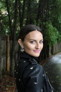 Girl wearing vintage earrings and leather jacket