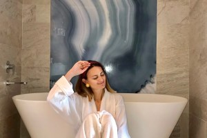 Women in spa wearing white robe