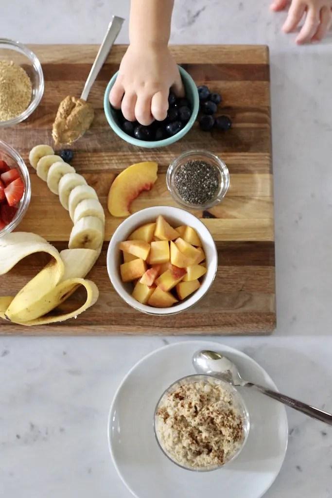Kids selecting fruit toppings for oatmeal_Emily Schiller RDN