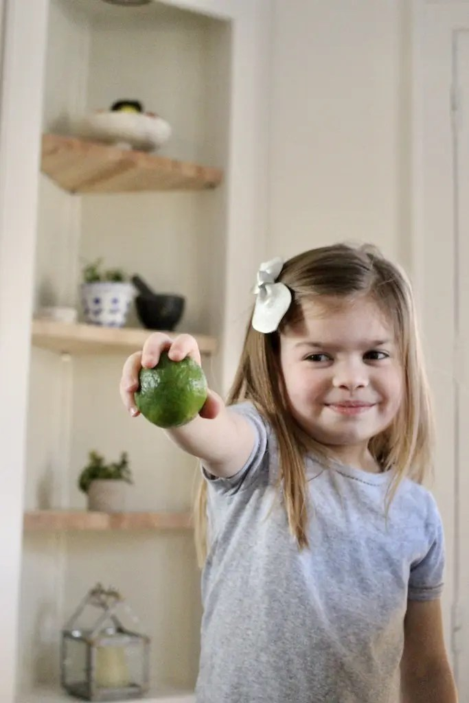 Young girl holding lime_Emily Schiller RDN