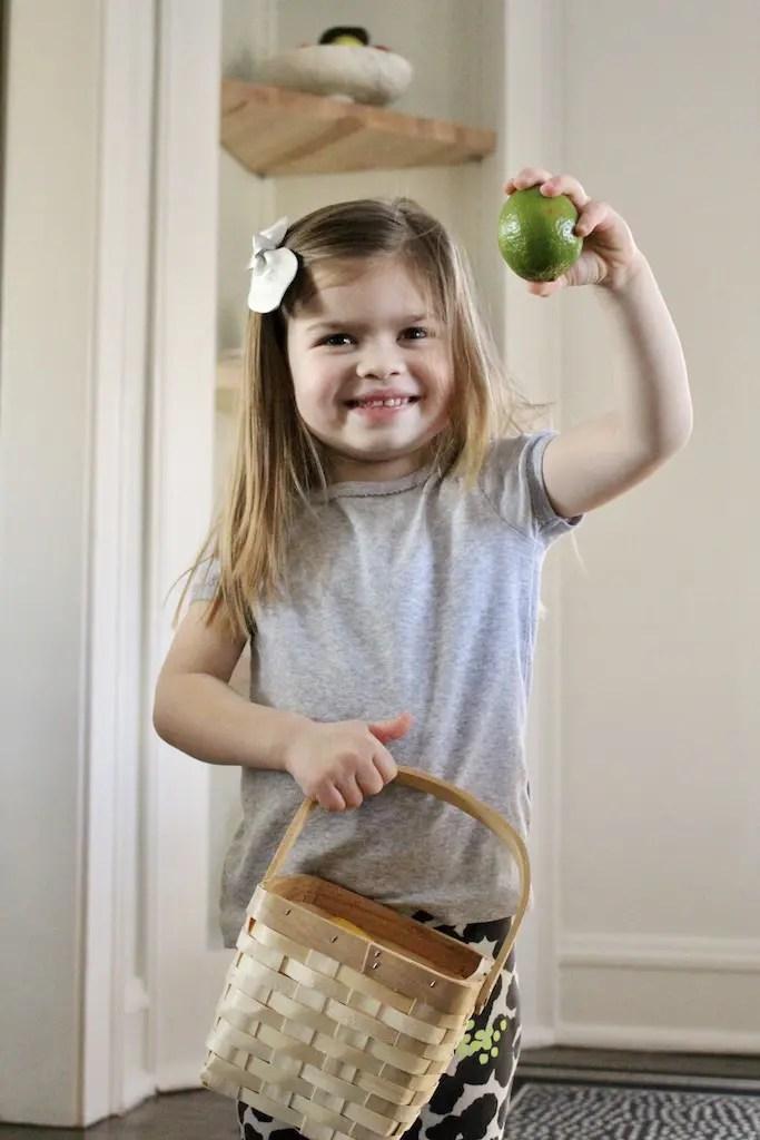 Girl holding lime_Emily Schiller RDN