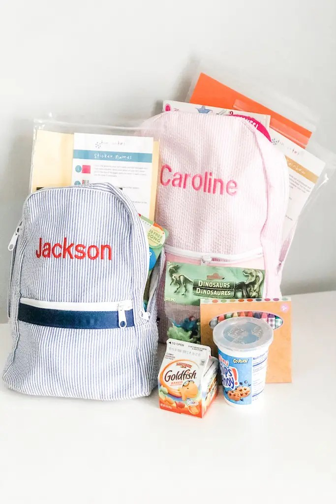 Children's monogrammed backpacks ready for a family trip.