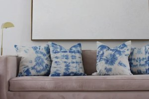 pink couch with indigo tie-dye pillow covers