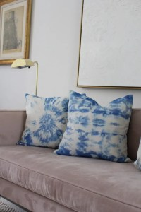 indigo tie-dye pillow on couch