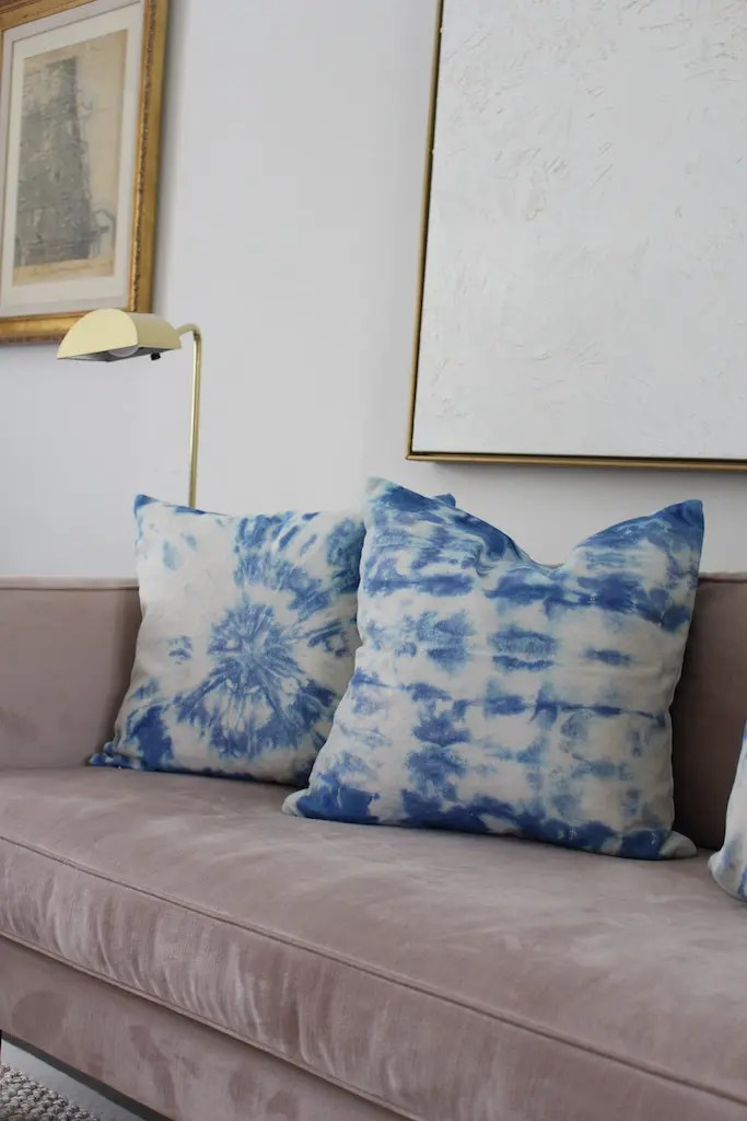indigo tie-dye pillow on couch
