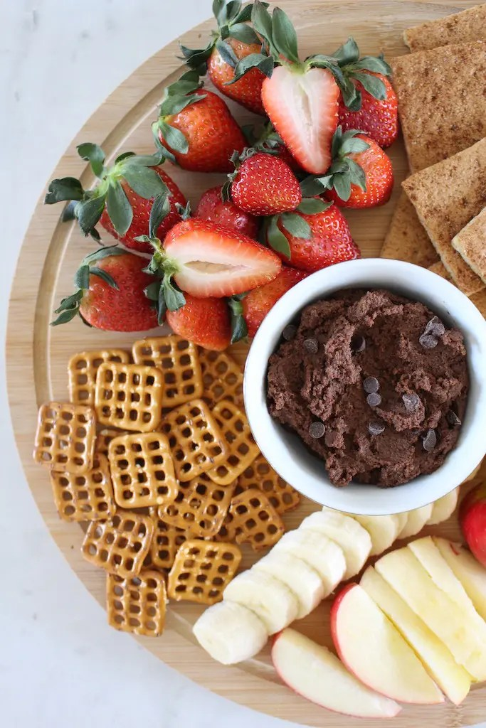 Chocolate chickpea dessert hummus with fruit and crackers