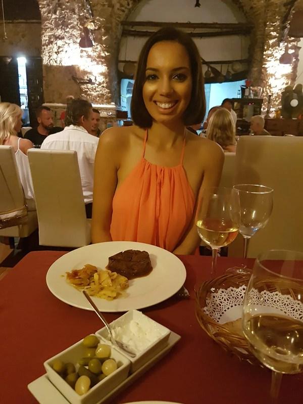 Girl eating at restaurant