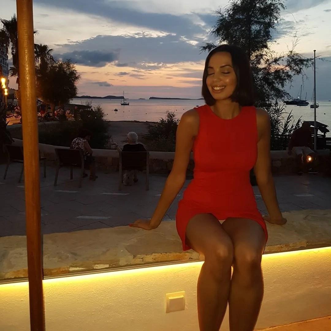 girl wearing red dress Ibiza sunset