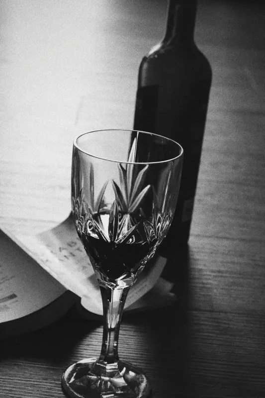 black and white wine glass and bottle for blog on steamy poem - The Style of Laura Jane